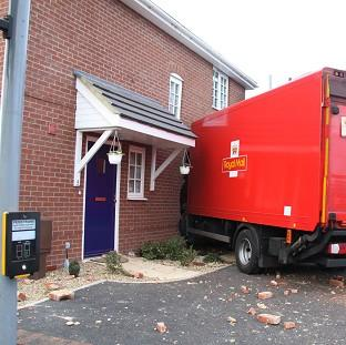 Romsey Advertiser: A Royal Mail lorry crashed into the side of a house in Gosport