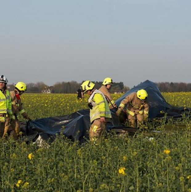 Romsey Advertiser: Emergency services at the scene of a plane crash near Ongar, Essex, where a Yak 52 aircraft's pilot and passenger, both from Essex, were killed after the plane flew out from North Weald airfield.