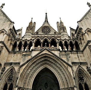 A brain-damaged cyclist has won his damages action at the High Court