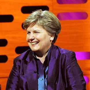 Comedienne Sandi Toksvig is collecting her OBE for services to broadcasting in a ceremony at Buckingham Palace today