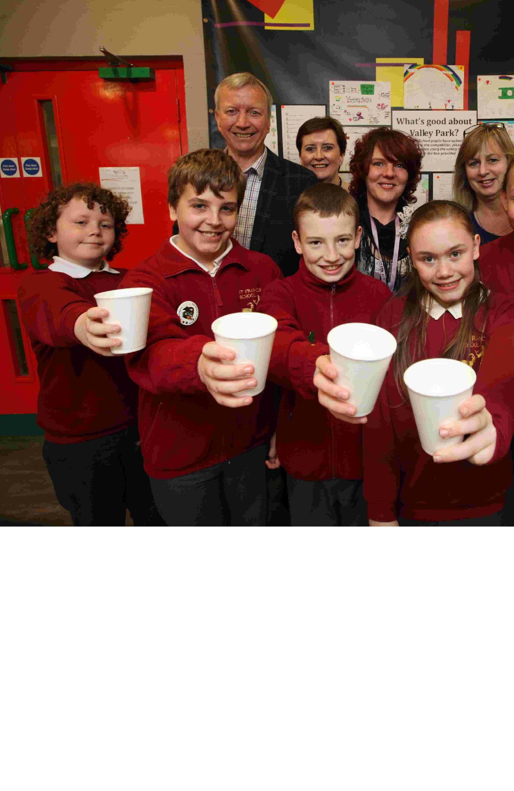 CHEERS! Pupils from St Francis School join (l-r) Cllr Alan Dowden, Cllr Kath Tilling, community