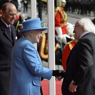 Romsey Advertiser: President of Ireland Michael D Higgins is greeted by the Queen and Prince Philip outside Windsor Castle