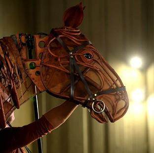 Musicians connected to War Horse are fighting to avoid being replaced by a soundtra