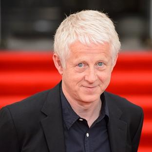 Richard Curtis says he may finally consider tying the knot