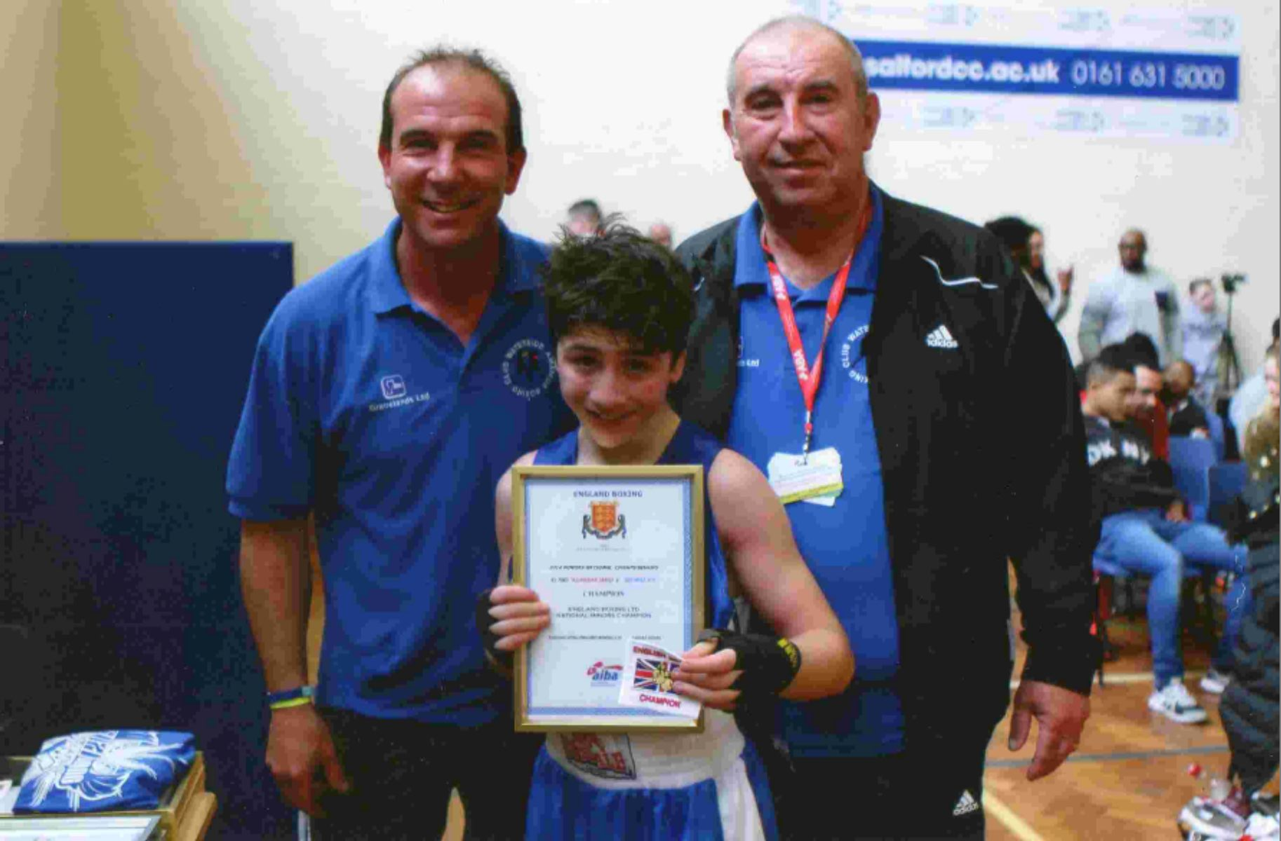 12-year-old amateur boxer George Joy, pictured with his coaches Stuart and George Pidgley from Waterside Amateur Boxing Club, celebrates his National Minors Championship win