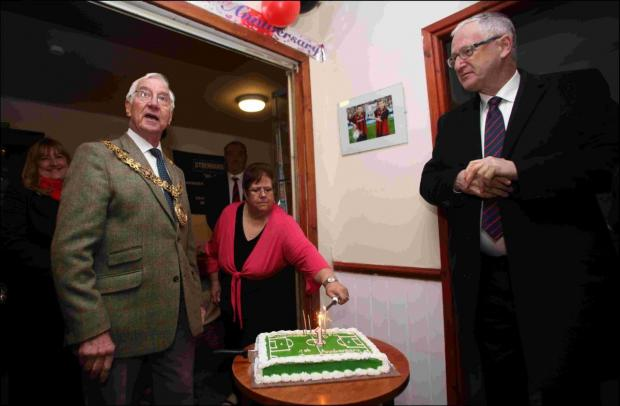 Mayor of Winchester, Cllr Ernie Jeffs, cut the cake for the celebrations (pictured left) with club chairman, Paul Murray (right)