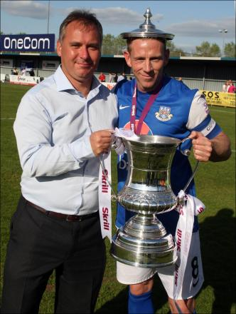 Stewart Donald celebrates Eastleigh's promotion with skipper Glenn Southam