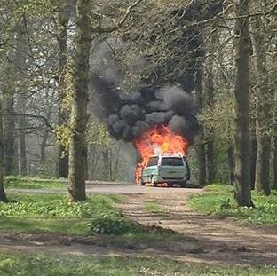 Romsey Advertiser: A 4x4-type car engulfed in flames at Longleat Safari Park,