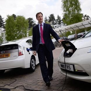 Romsey Advertiser: Deputy Prime Minister Nick Clegg charges an electric car during a visit to the Transport Research Laboratory in Berkshire