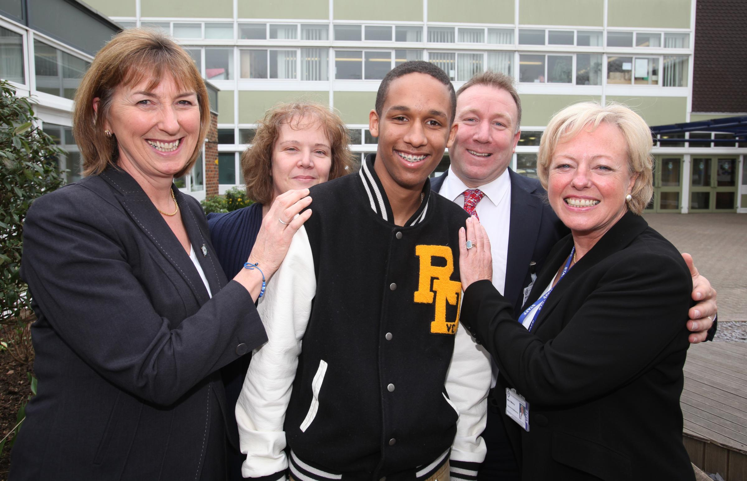 Sam Mangoro with Mountbatten headteacher, Heather McIlroy and other members of staff