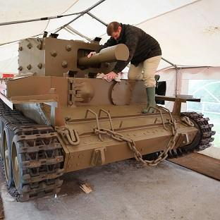 Romsey Advertiser: Nicolas Dumont works on a centaur tank which has been restored after lying abandoned on the banks of the Caen Canal near Pegasus Bridge since the Normandy Landings