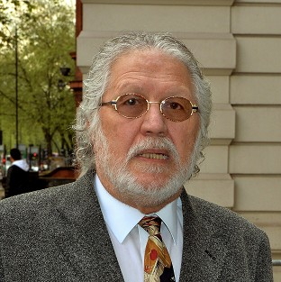 Veteran DJ Dave Lee Travis is accused of indecently assaulting a woman