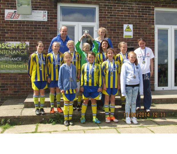 Romsey Advertiser: CHAMPS: Romsey Town Youth girls under-12s celebrate their penalty shoot-out cup final win over Gosport .