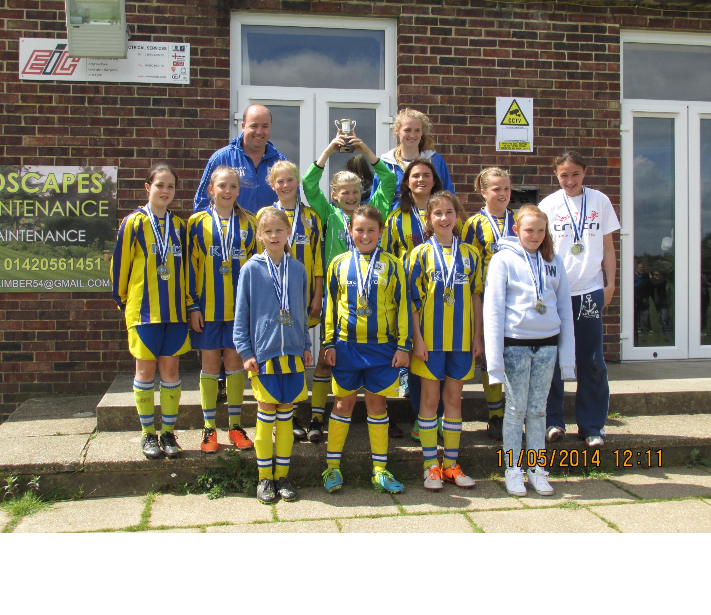 CHAMPS: Romsey Town Youth girls under-12s celebrate their penalty shoot-out cup final win over Gosport .