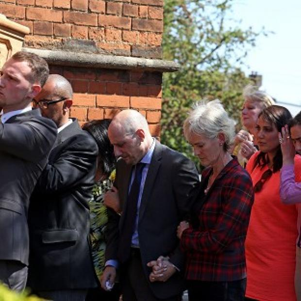 Romsey Advertiser: Judy Murray with Nino Severino follows the coffin of former tennis player Elena Baltacha into church.