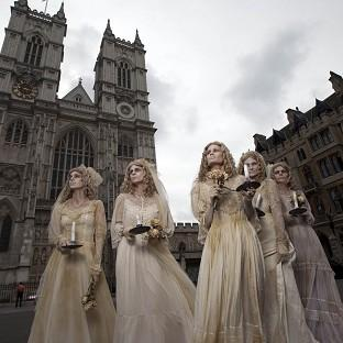 Romsey Advertiser: A group of five actresses dressed as the Charles Dickens character Miss Havisham, outside Westminster Abbey