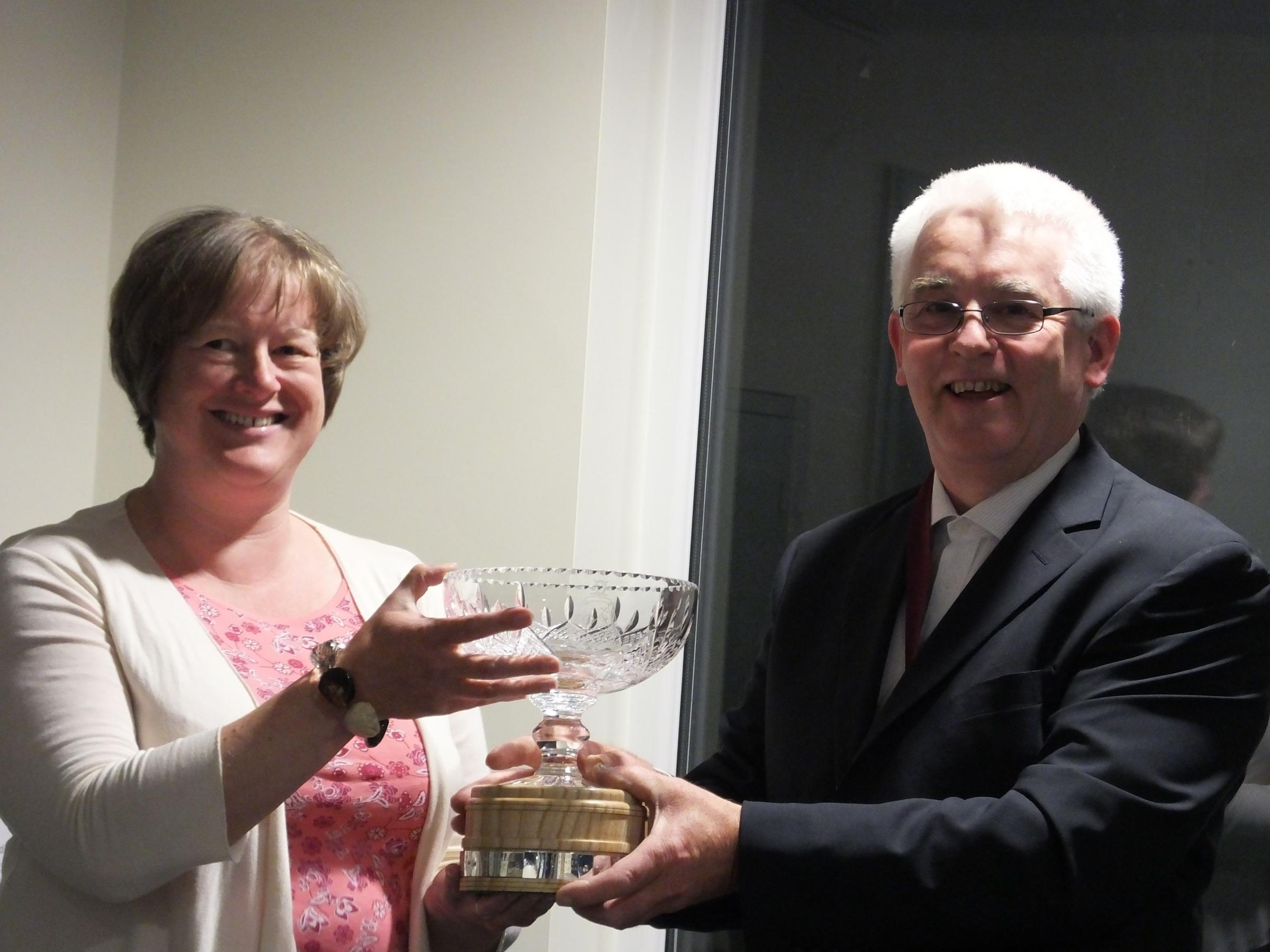 Tracy Hickson ecives her award from parish council chairman, David Knight