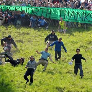 Rebel cheese rollers staged their own unofficial event after health and safety fears caused the official competition to be cancelled in 2010