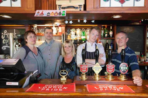 Landlady Sharron Bruty (pictured left) and her husband Chris (far right) run the pub with their members of staff.