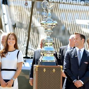Romsey Advertiser: The Duchess of Cambridge with Sir Ben Ainslie in front of the America's Cup during a visit to the National Maritime Museum, London