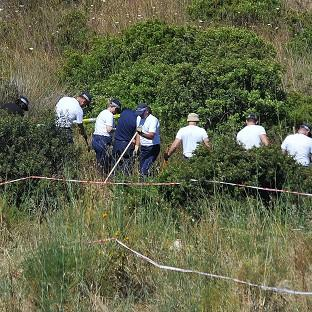 Romsey Advertiser: Police investigating the disappearance of Madeleine McCann in Portugal search a patch of scrubland