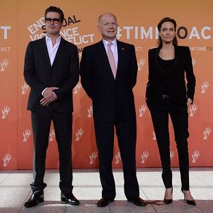 Romsey Advertiser: Foreign Secretary William Hague (centre), Brad Pitt and Angelina Jolie arrive at the End Sexual Violence in Conflict Summit at the Excel centre in east London.