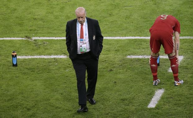 Romsey Advertiser: Spain's head coach Vicente Del Bosque, left, walks through the coach zone during the group B World Cup soccer match between Spain and Chile at the Maracana Stadium in Rio de Janeiro, Brazil, Wednesday, June 18, 2014.  (AP Photo/Christophe Ena). (73040