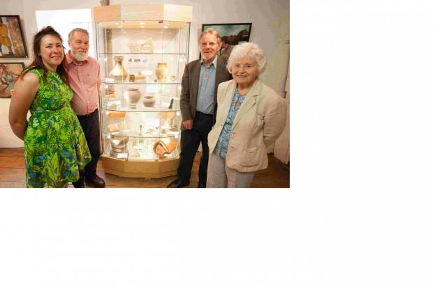 Romsey Advertiser: Anne James, manager, Kevin Stubbs, archeologist, Dave Allen, chief archeologist at Hampshire County Museums Service, and Barbara Burnbridge, trustee and local historian, with the artefacts recently returned to King John's House  in Romsey