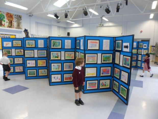 The children's work was professionally framed and displayed by a local art exhibition company