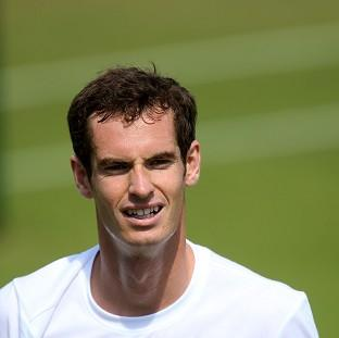 Romsey Advertiser: Andy Murray smiles during his practice session at Wimbledon