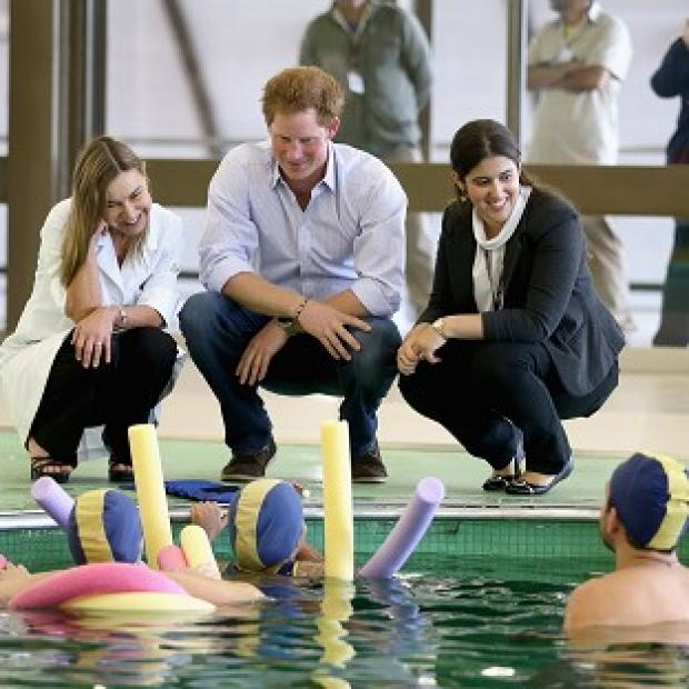 Romsey Advertiser: Prince Harry meets patients in the Rede Sarah Hospital for Nerological Rehabilitation injuries during his visit to the hospital in Brasilia
