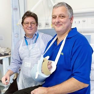 Professor Simon Kay (left) carried out the first hand transplant in the UK on Mark Cahill (r