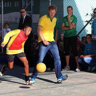 Prince Harry plays football with children at the Acer Community project in Diadema near Sao Paolo
