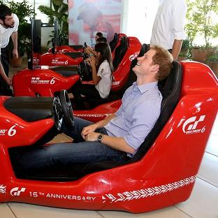 Prince Harry on a Formula 1 driving simulator during his visit to the Ayrton Senna Institute in Sao Paulo
