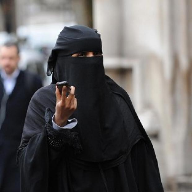 Romsey Advertiser: A woman wears a burka in London