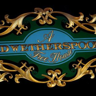 Romsey Advertiser: A JD Wetherspoon logo, as the pub chain is to cut the opening times of its outlets at the weekends in response to late-night levies being introduced by local councils