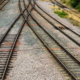 Two people have died after being struck by a freight train at a footpath crossing
