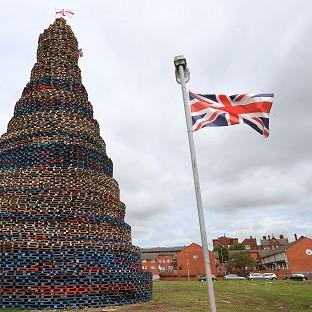 An unlit bonfire in the lower Shankill Road area of West Belfast