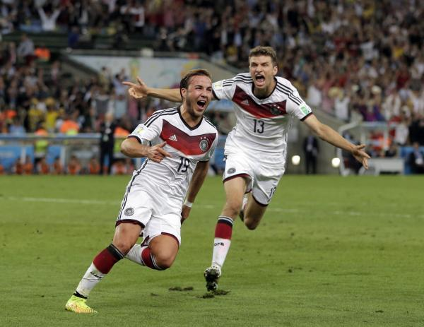 Mario Gotze celebrates his extra time winner in the World Cup final
