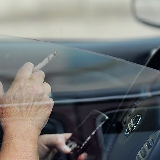 Mobile phone car penalty may double