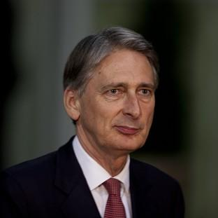 Defence Secretary Philip Hammond has blamed the latest fighting on Hamas (AP)