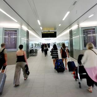 Passengers walking through Gatwick as the airport is bringing in its own staff to help with the luggage crisis amid fears there could be further chaos this weekend
