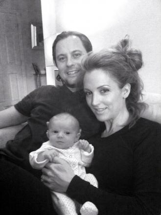Quinton Garrathy with his wife Naomi and daughter Olivia-Rae.