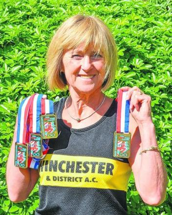 Moira West with her medals
