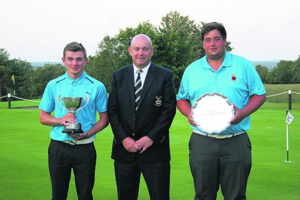 Ben Wall, right, with his trophy. Scott Gregory is pictured left.