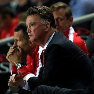 Louis van Gaal watches on as his side are thu