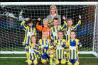 NEW DEAL: Romsey Town under-eights with Lady Brabourne and their new kit. Order no: 19727739