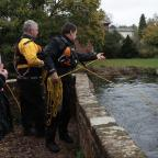 Romsey Advertiser: Polcie officers searching in the River Test