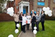 BRIGHT SMILES: Staff at Oasis Dental Care in Woolston, Southampton celebrate on the open day for their newly refurbished practice.