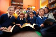 Pupils in the library enjoying their books.